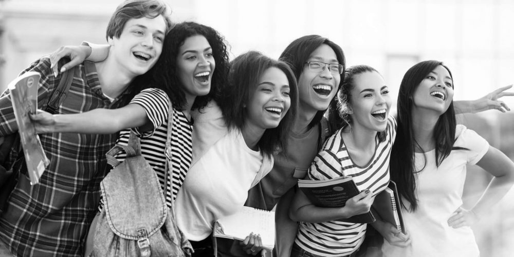 multiethnic-group-young-happy-students-standing-outdoors